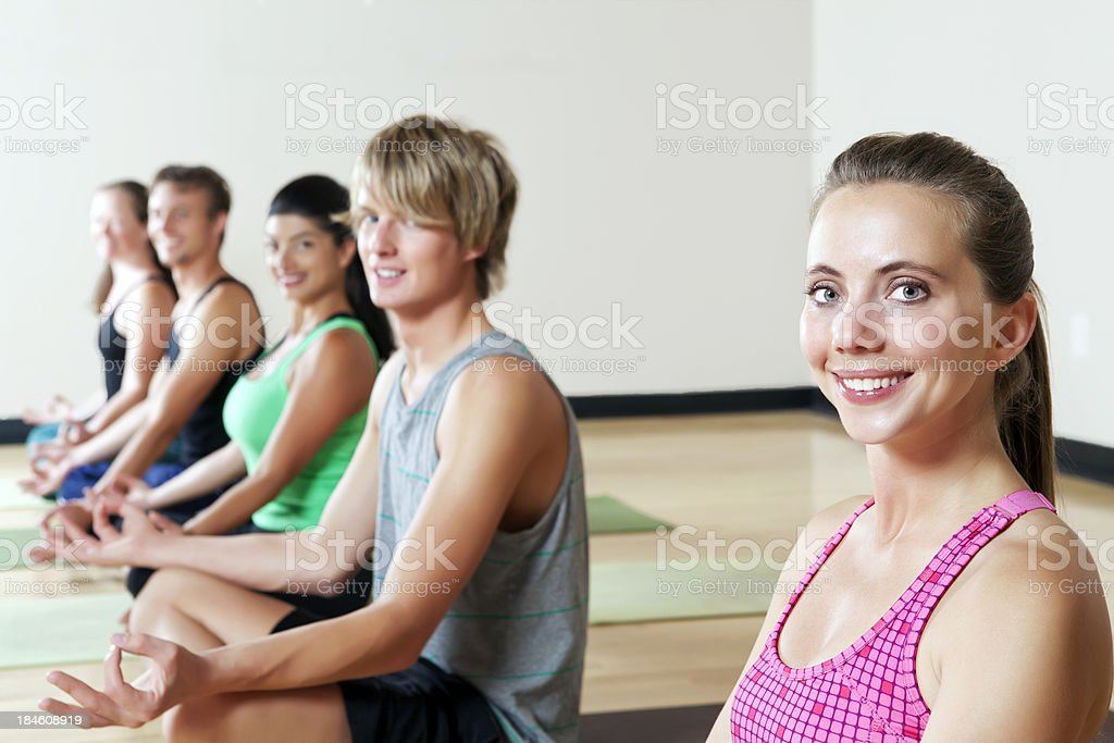 Wellness: Happy Relaxed girl in a yoga class royalty-free stock photo