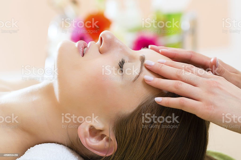 Wellness spa with woman getting head massage stock photo