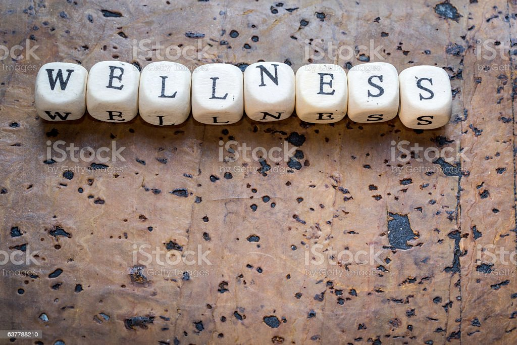 Wellness text on a wooden cubes stock photo