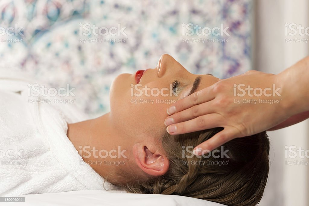 Wellness - woman getting head massage in Spa royalty-free stock photo