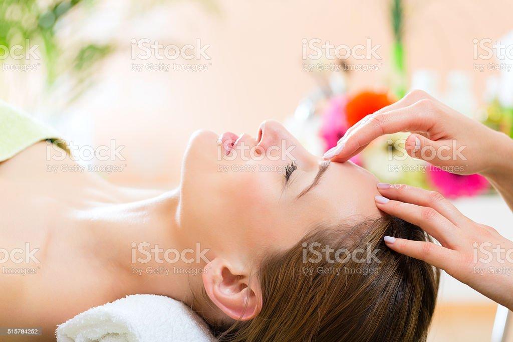 Wellness - woman getting head massage in Spa stock photo