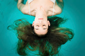 Wellness - young woman floating in Spa or swimming pool