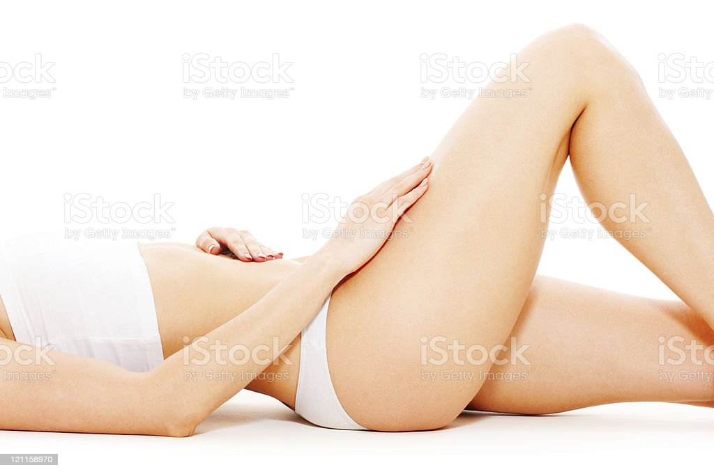 Well-tones female body with smooth legs and flat tummy royalty-free stock photo