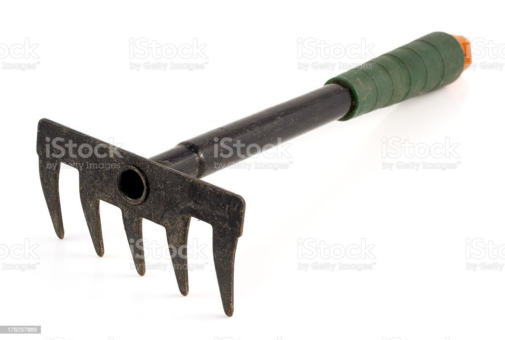well-used garden rake hand tool royalty-free stock photo