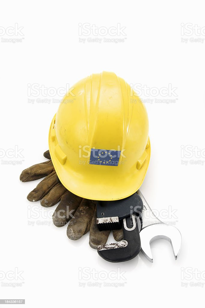 Well-used hard hat with the E.U. flag royalty-free stock photo