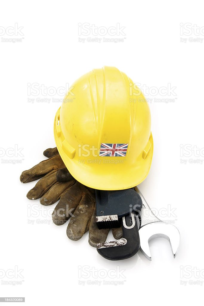 Well-used hard hat with the U.K. Union Jack flag stock photo