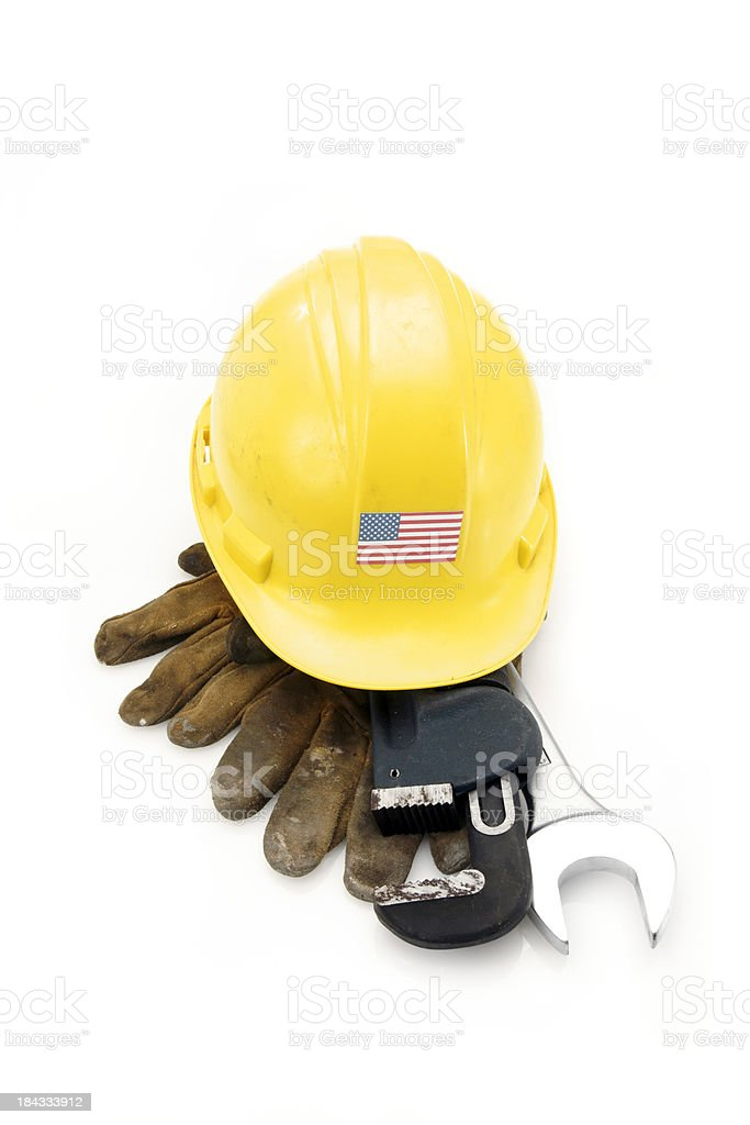 Well-used hard hat with the U.S. Stars and Stripes flag stock photo