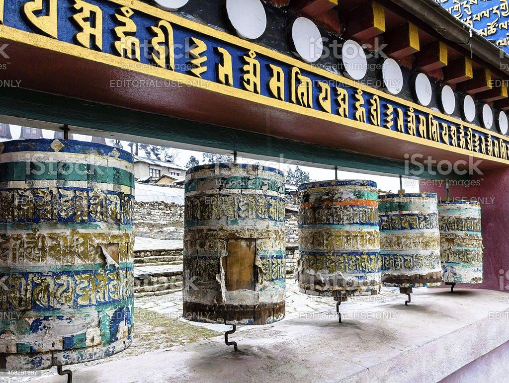 Well-used Prayer Wheels at Tengboche Monastery Nepal royalty-free stock photo
