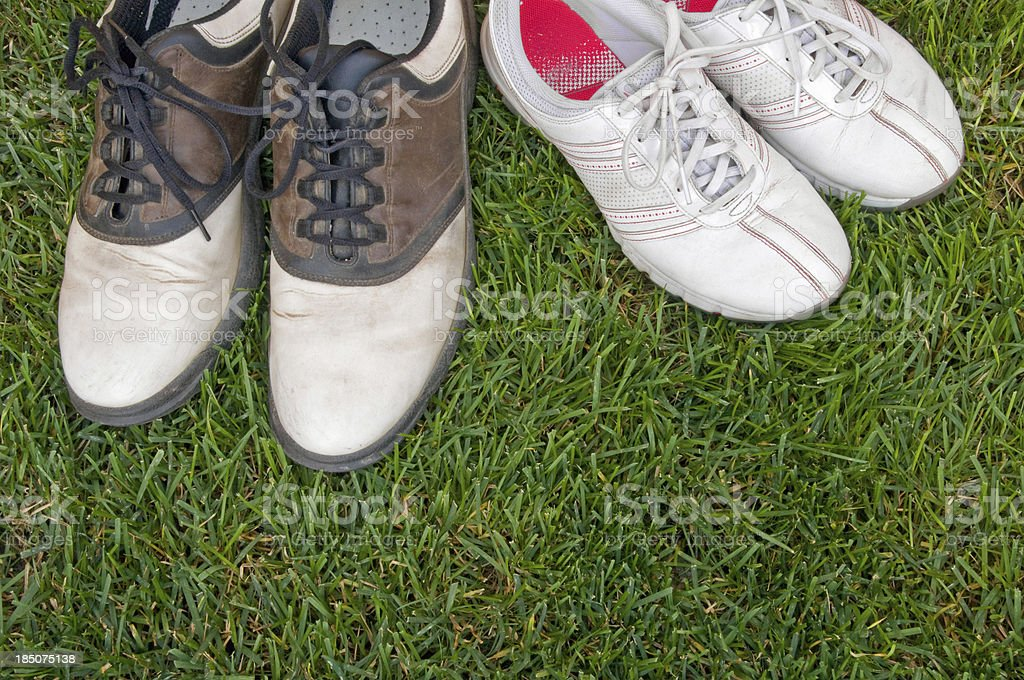 Well-worn men's and women's golf shoes royalty-free stock photo