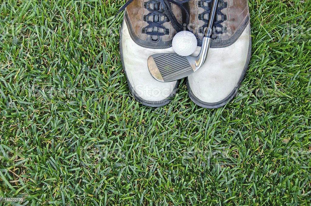 Well-worn men's golf shoes stock photo