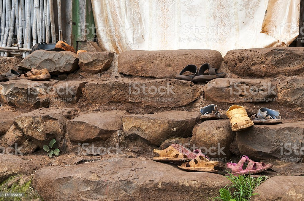 Well-worn shoes on church steps in Ethiopia stock photo