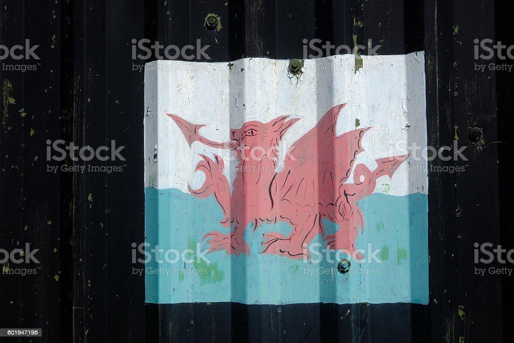 Welsh flag on corrugated iron stock photo