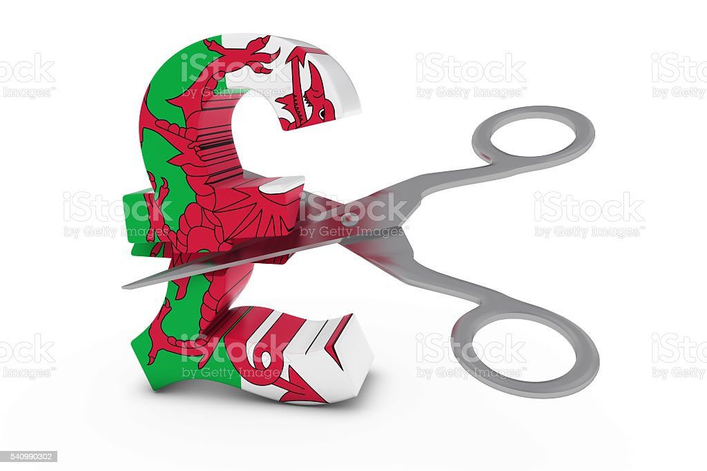 Welsh Flag Pound Symbol Cut in Half with Scissors stock photo