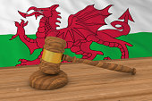 Welsh Law Concept - Flag of Wales Behind Judge's Gavel