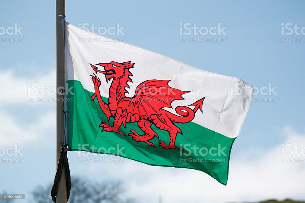 Welsh National Flag Flying in the Wind, Llandudno, Wales, UK stock photo