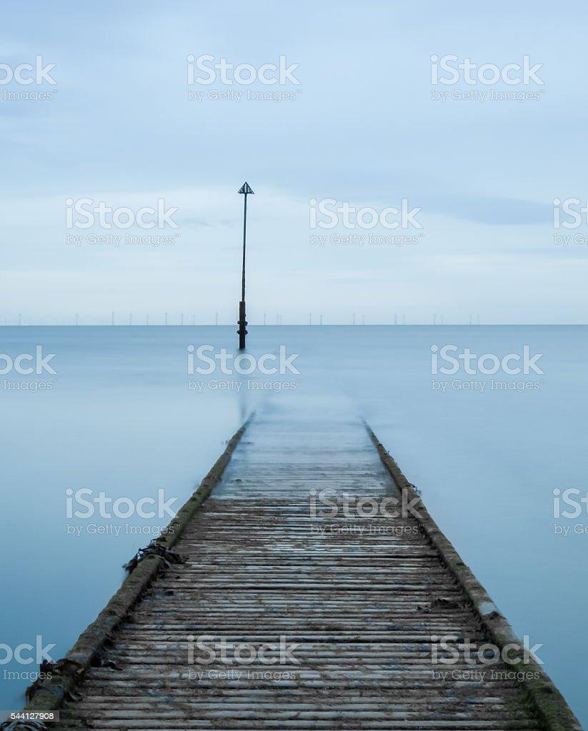 Welsh Pier Walking by the Sea (Portrait) stock photo
