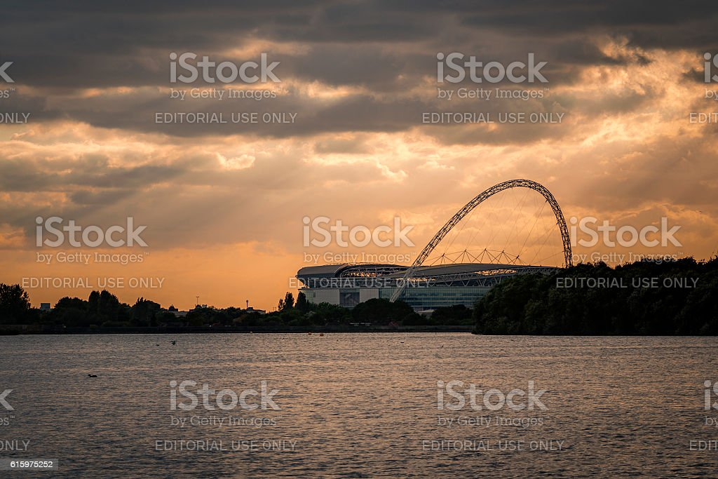 Wembley stadium from across the lake at sunset stock photo