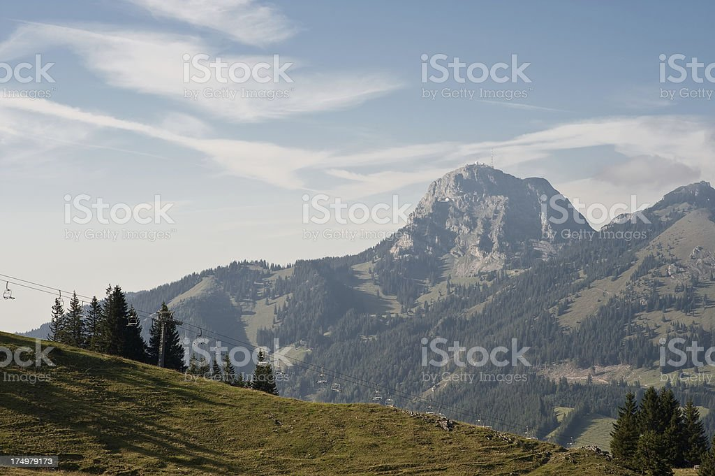Wendelstein mountain peak with chair lift in the foreground stock photo