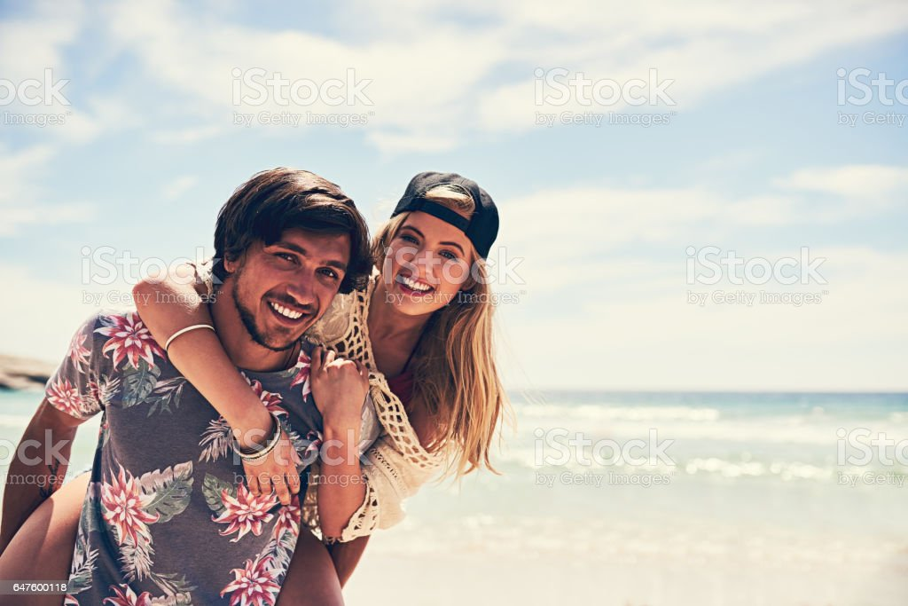 We're a couple of beach lovers stock photo