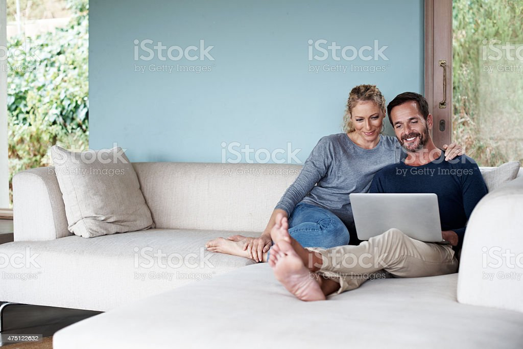 We're enjoying our weekend surfing stock photo