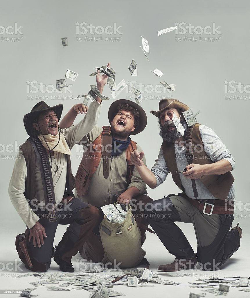 We're rich!! No more cattle rustling for us! stock photo