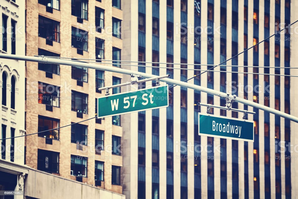 West 57 Street and Broadway hanging signs in Manhattan, NYC. stock photo
