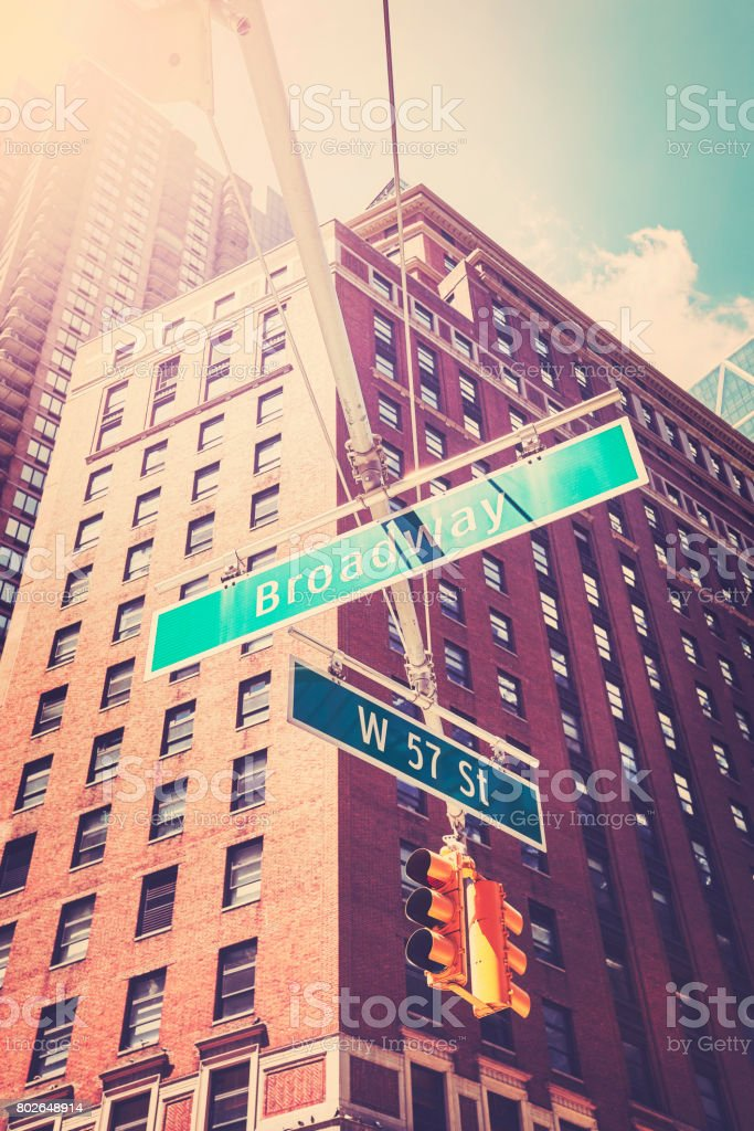 West 57 Street and Broadway street signs in Manhattan. stock photo