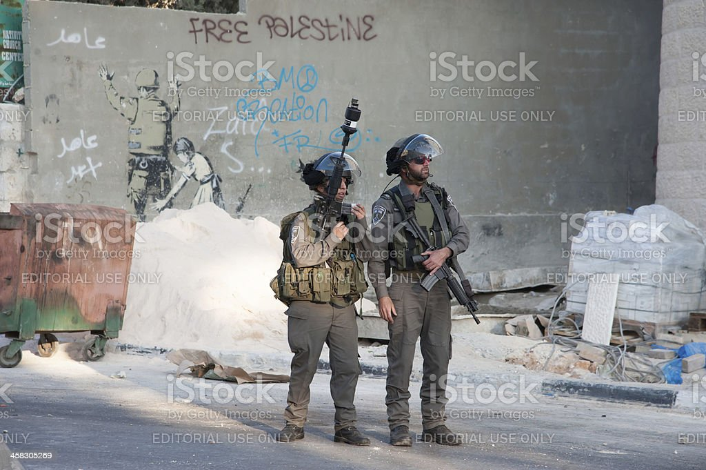 West Bank Israeli military occupation and Banksy mural stock photo