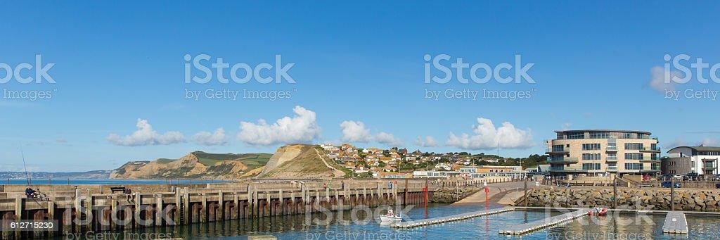 West Bay harbour Dorset uk view to Golden Cap panorama stock photo