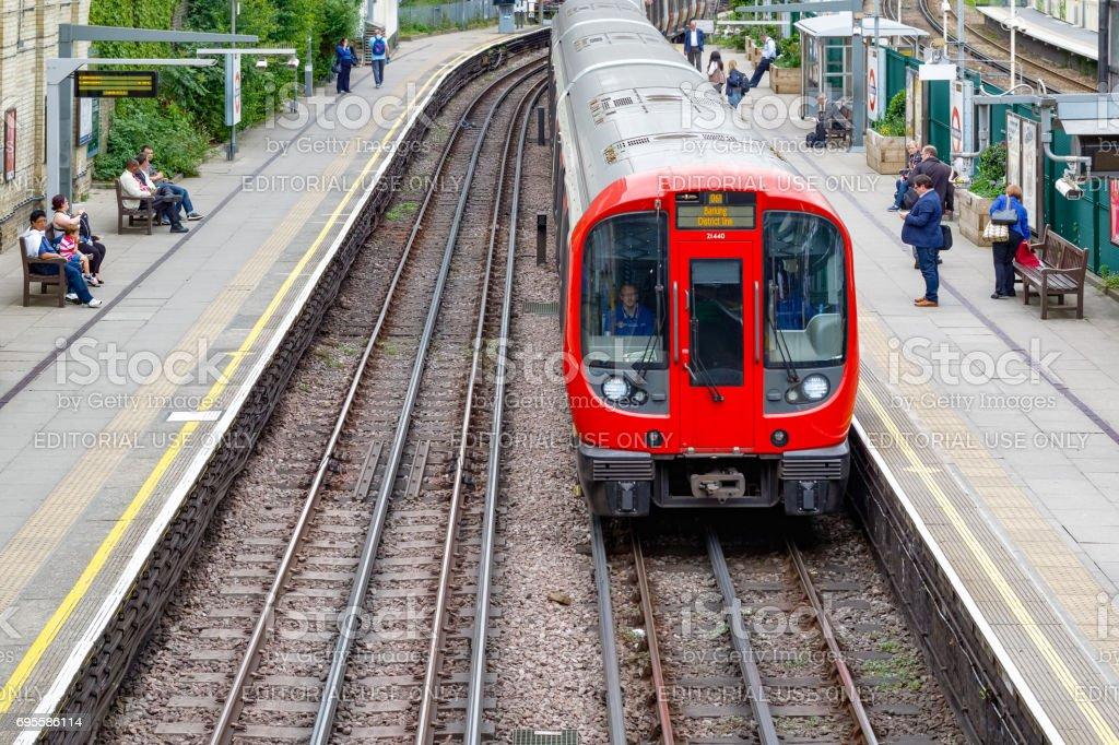 West Brompton underground station platforms, with northbound train arriving stock photo