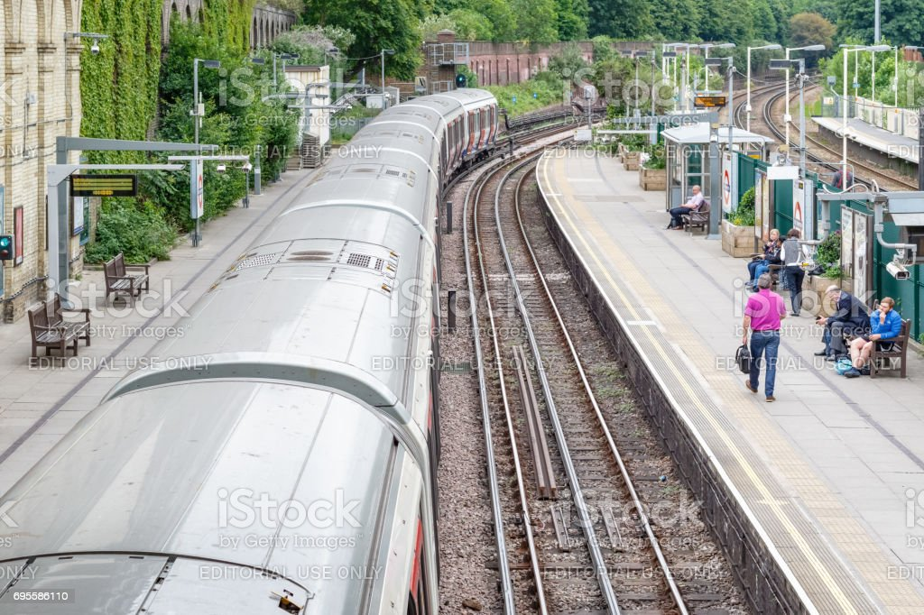 West Brompton underground station platforms, with southbound train leaving from platform stock photo