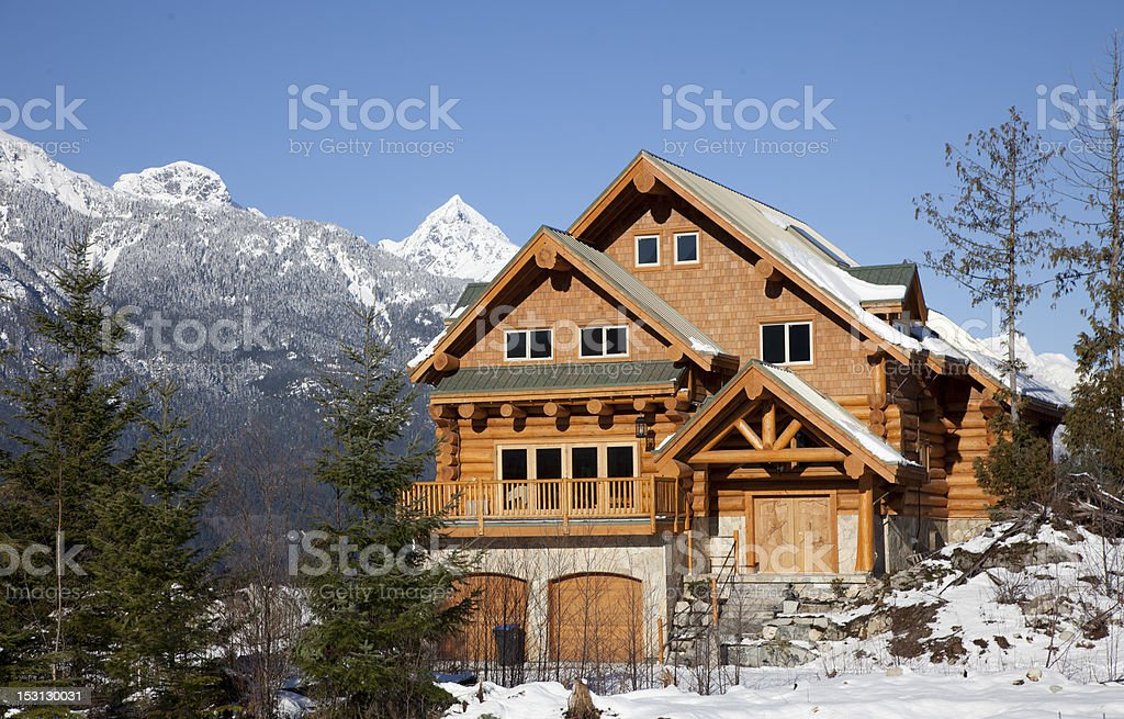 A west coast wooden house during winter in mountains stock photo
