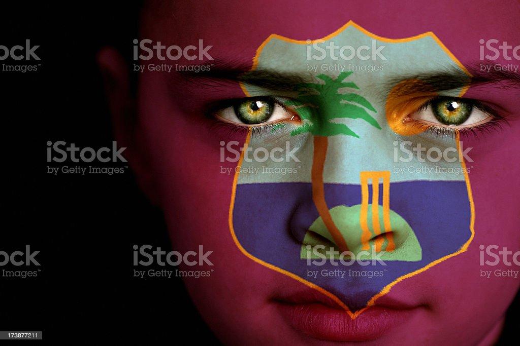 West Indies flag boy stock photo