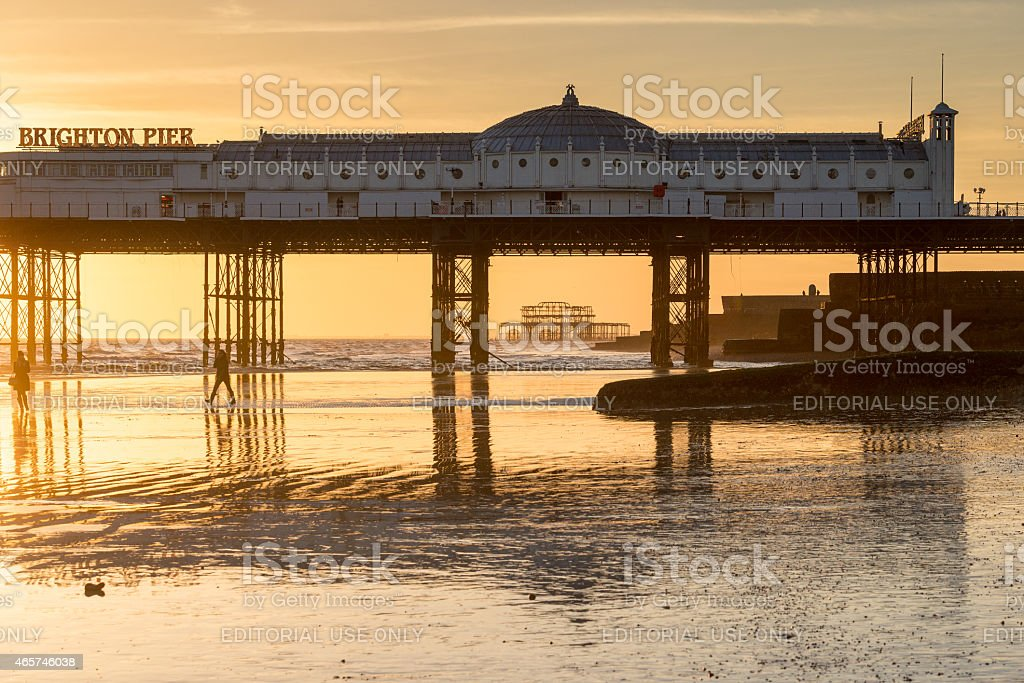 West Pier through the supports of the Palace Pier stock photo