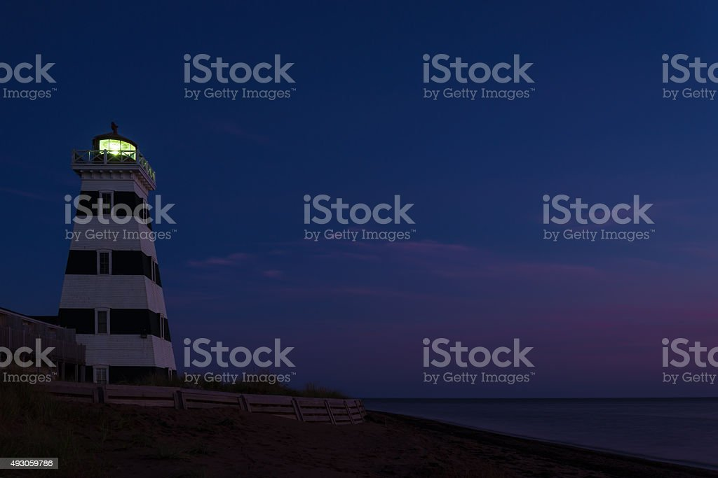 West Point Lighthouse at dusk stock photo
