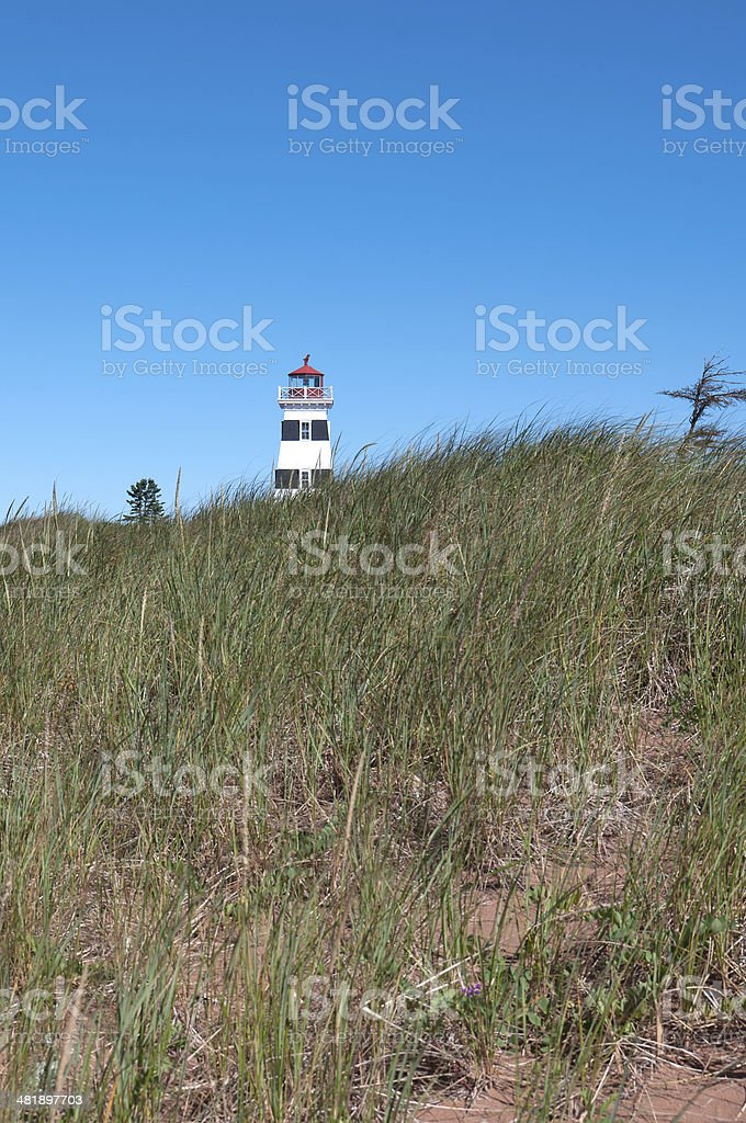 West Point Lighthouse by Grass Dunes, PEI royalty-free stock photo