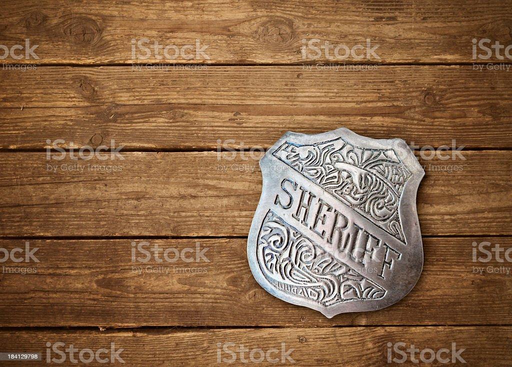 Western background with vintage sheriff badge royalty-free stock photo