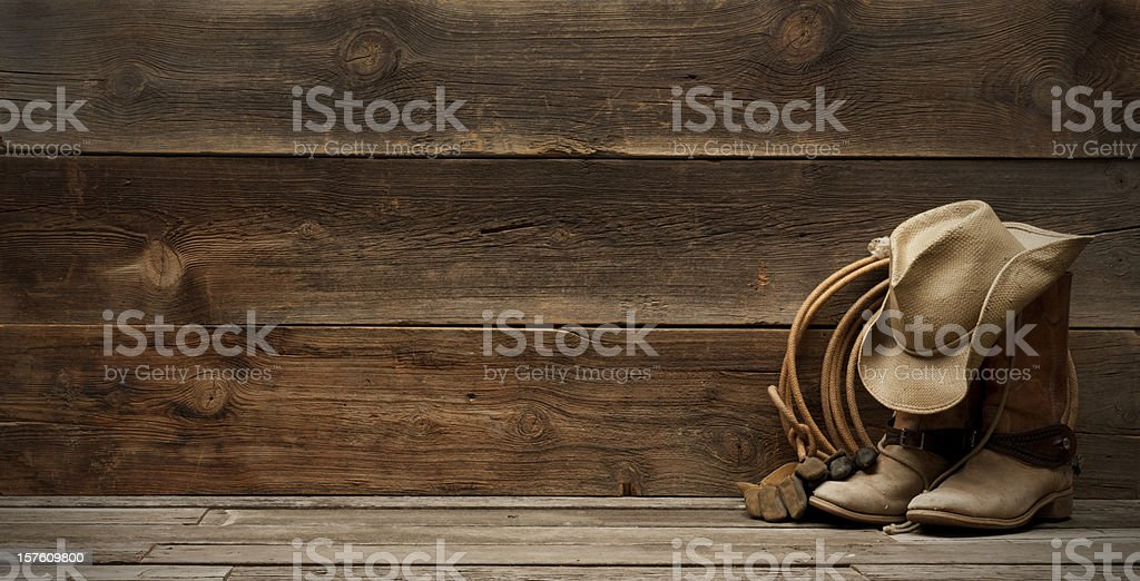 Western barnwood background w/boots,hat,lasso-extra wide stock photo