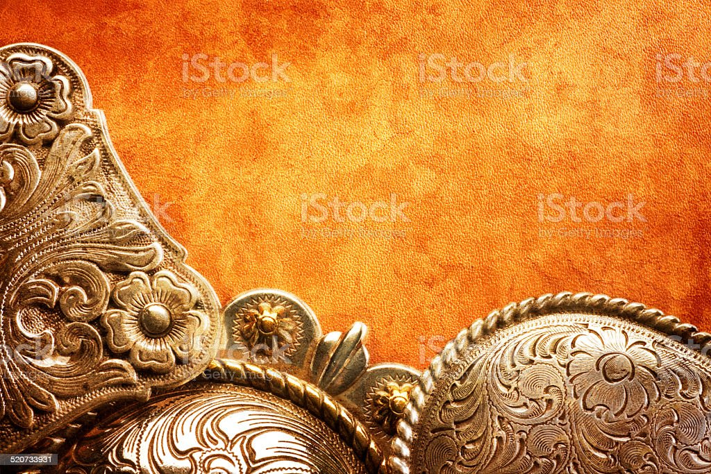 Western Belt Buckles On Textured Leahter Surface stock photo