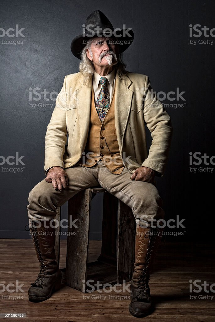 Western Cowboy Portrait With Boots And Hat stock photo