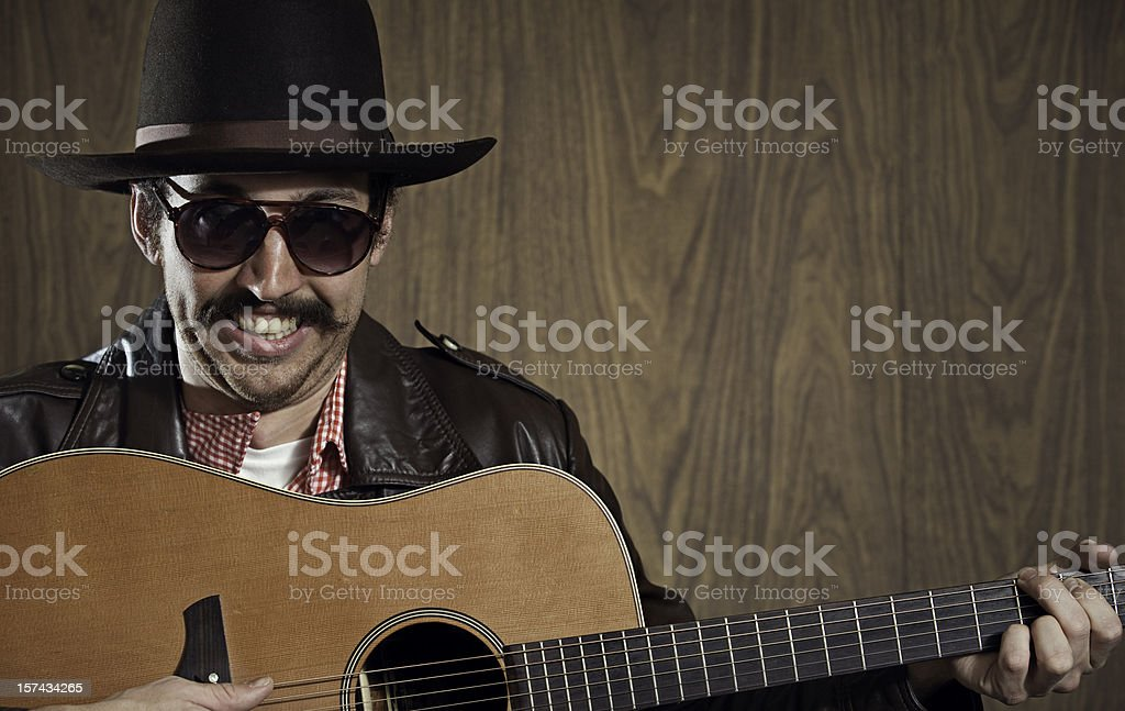 Western Cowboy with Mustache and Guitar royalty-free stock photo