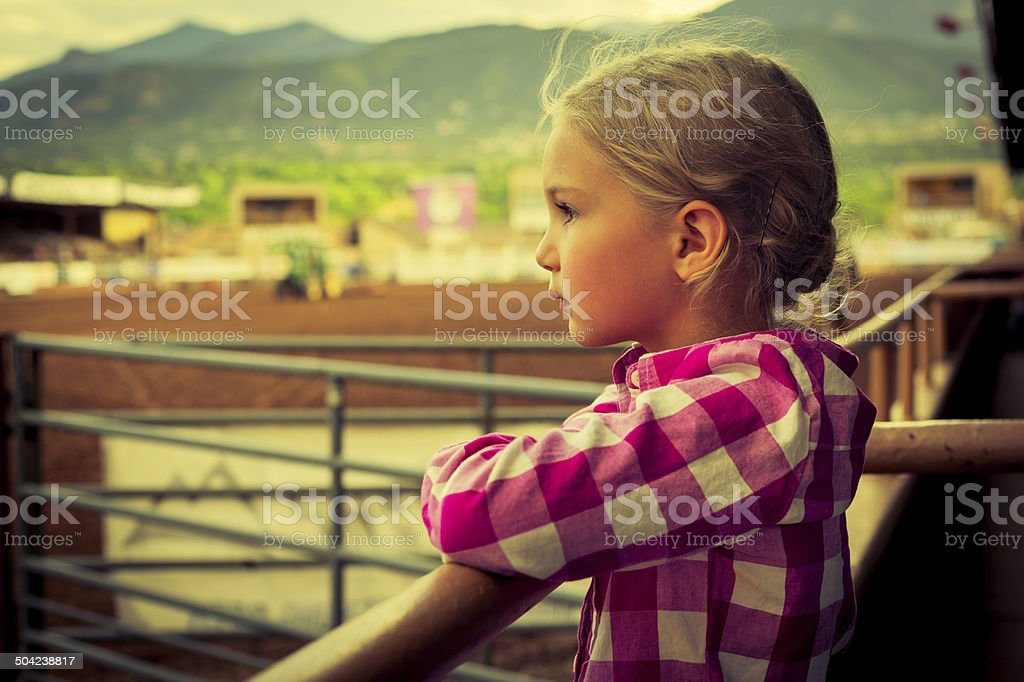 Western Cowgirl Dreaming at the Rodeo stock photo