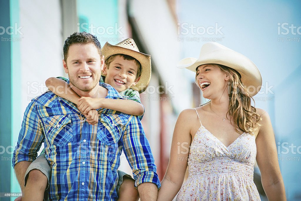 Western family having fun stock photo