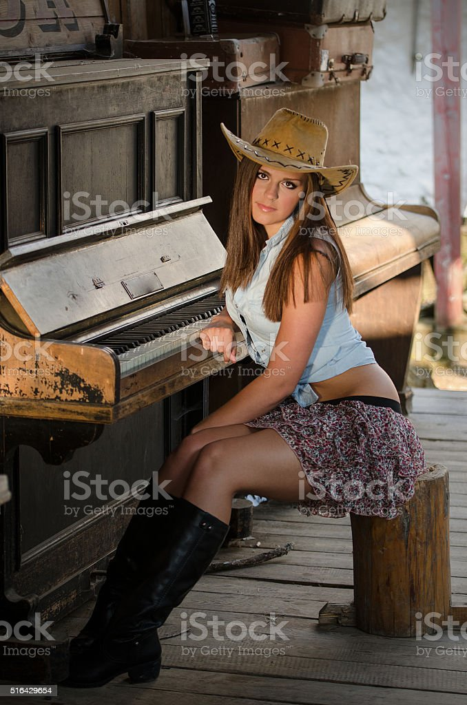 Western girl and piano stock photo