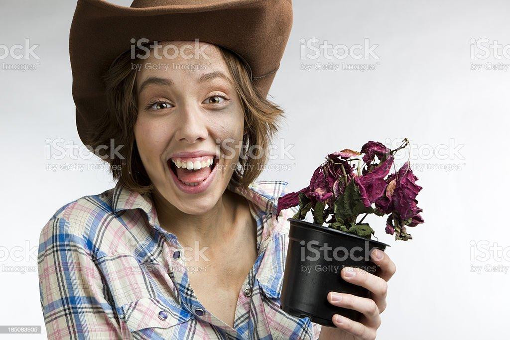 western girl holds dead poinsettia flower royalty-free stock photo