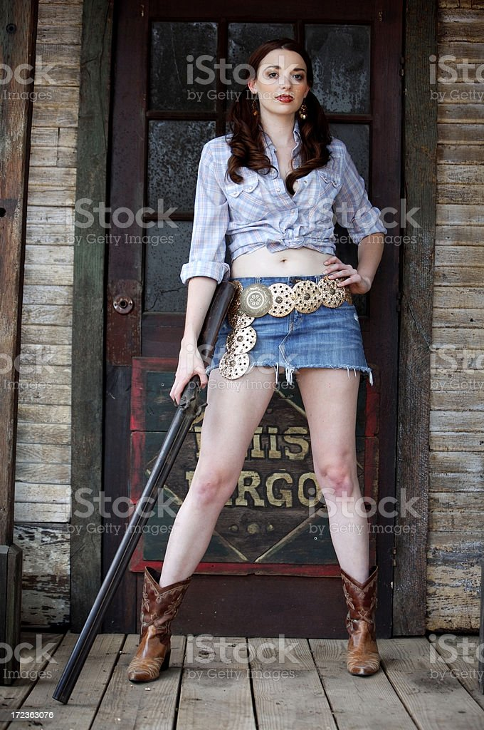 Western girl with a gun royalty-free stock photo