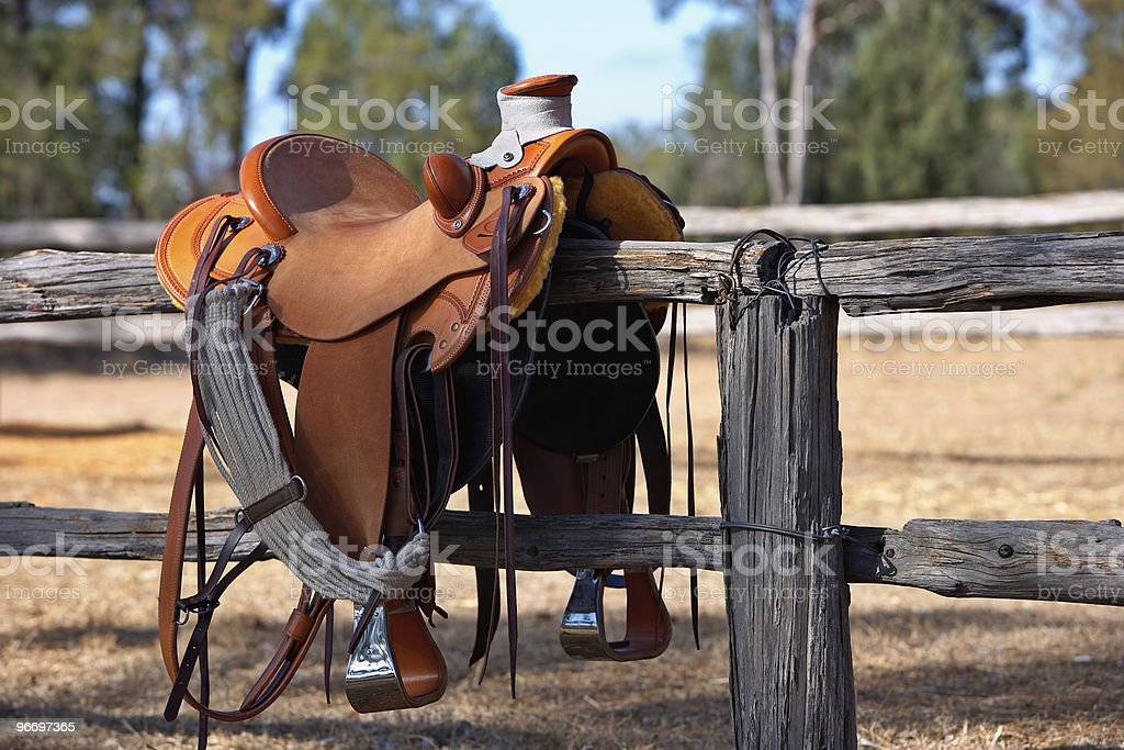 Western Horse Saddle and Fence stock photo