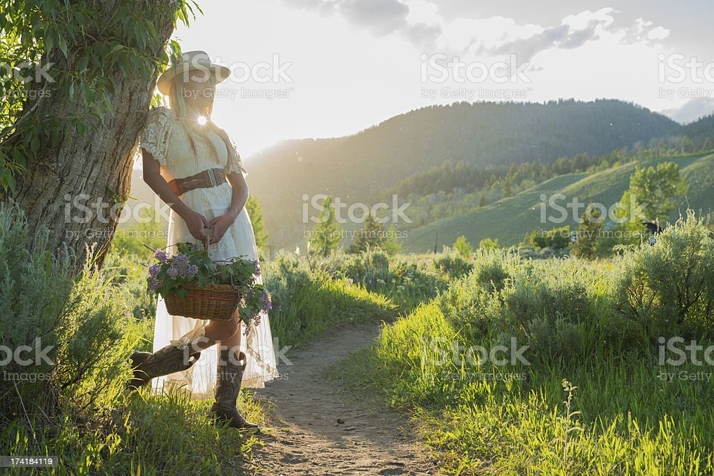 Western Montana Girl with Hand Picked Flowers royalty-free stock photo