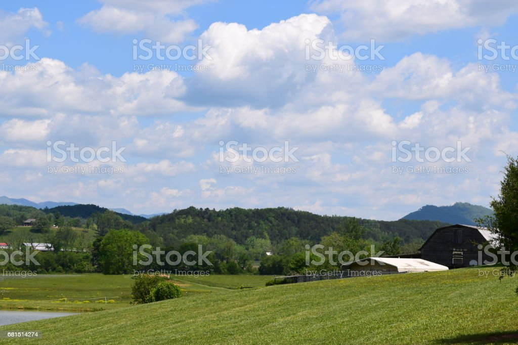 Western NC farm with rolling clouds stock photo