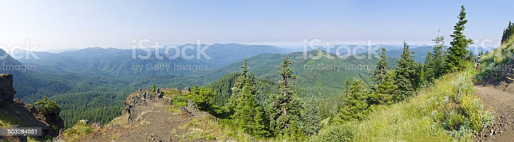 Western Oregon Mountain Peak Forest Smokey Sky with  Woman Hiker royalty-free stock photo